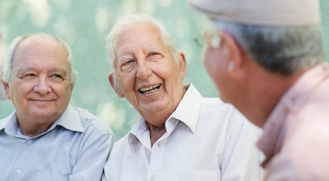 Group of happy elderly men laughing and talking